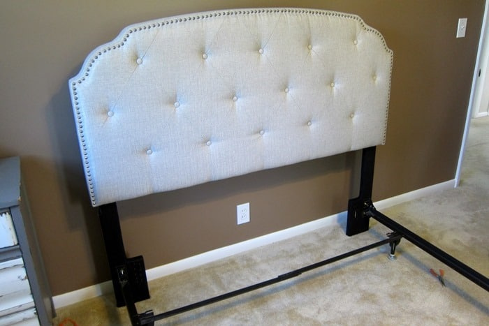 new upholstered headboard attached to bed frame