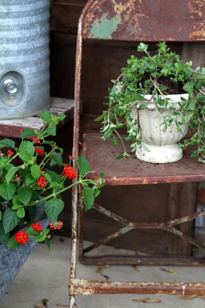 rusty pots and reclaimed chairs make great porch decorations