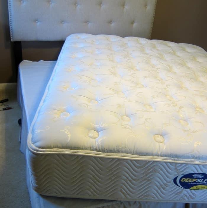 sliding a mattress onto the boxsprings
