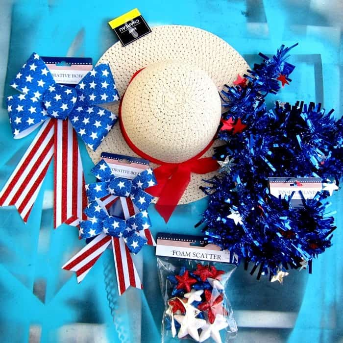 Supplies to make a Patriotic red white and blue Summer hat wreath from the Dollar Tree