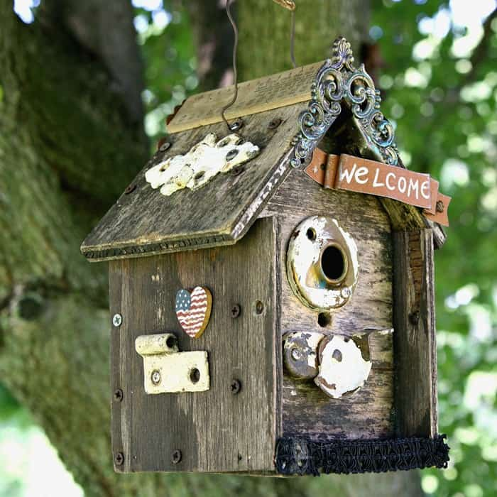 100 cheap diy home decorating projects, Update An Old Birdhouse With Vintage Hardware And Bits Of Jewelry