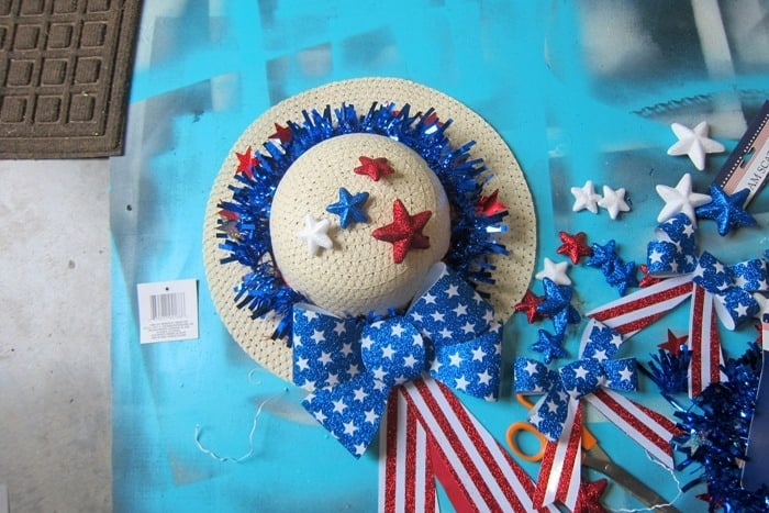 adding stars to a patriotic wreath
