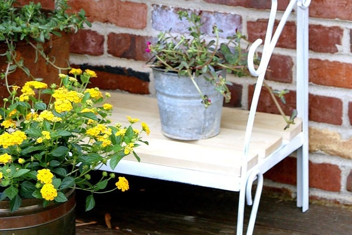 flower containers on a rustic plant stand