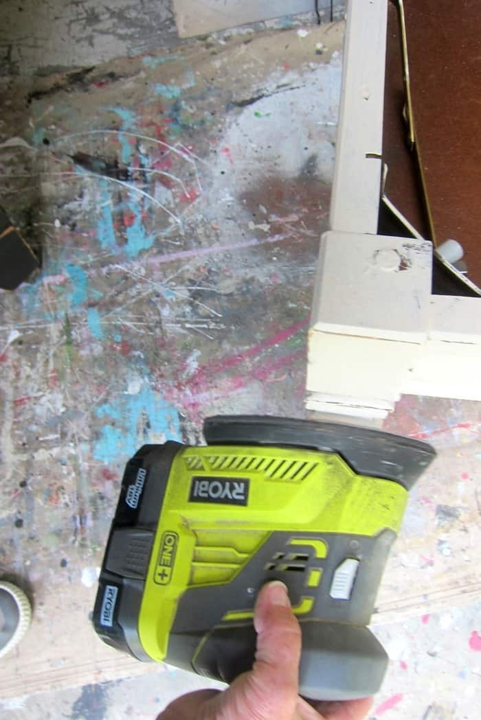 how to distress paint with a power sander
