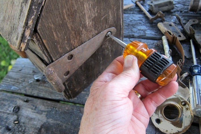 use screws to add hinges to a birdhouse