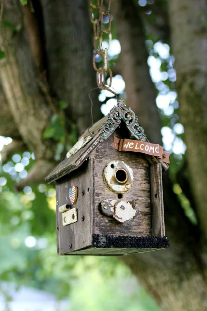 wood birdhouse makeover with door hardware and salvaged jewelry