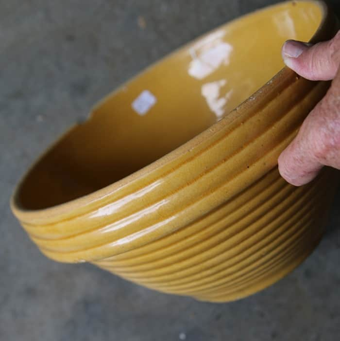 yellow pottery bowl, in auction box lot, in