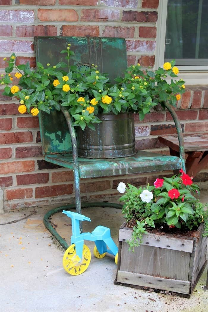 Lantana flowers and touches of whimsy with vintage toys on the front porch