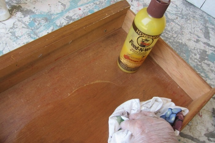 cleaning a furniture drawer with Howard's feed n wax
