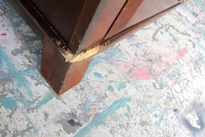corner of furniture needs repair with wood putty