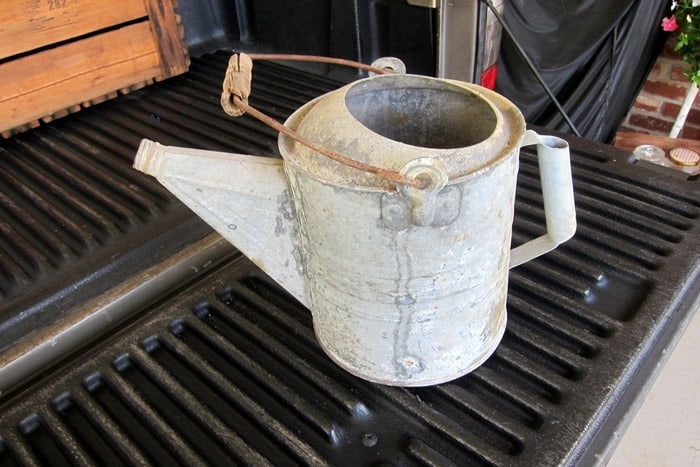old galvanized watering can