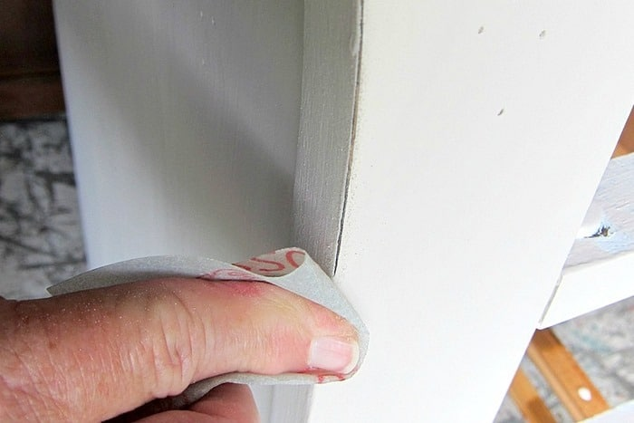 sanding and distressing furniture by hand