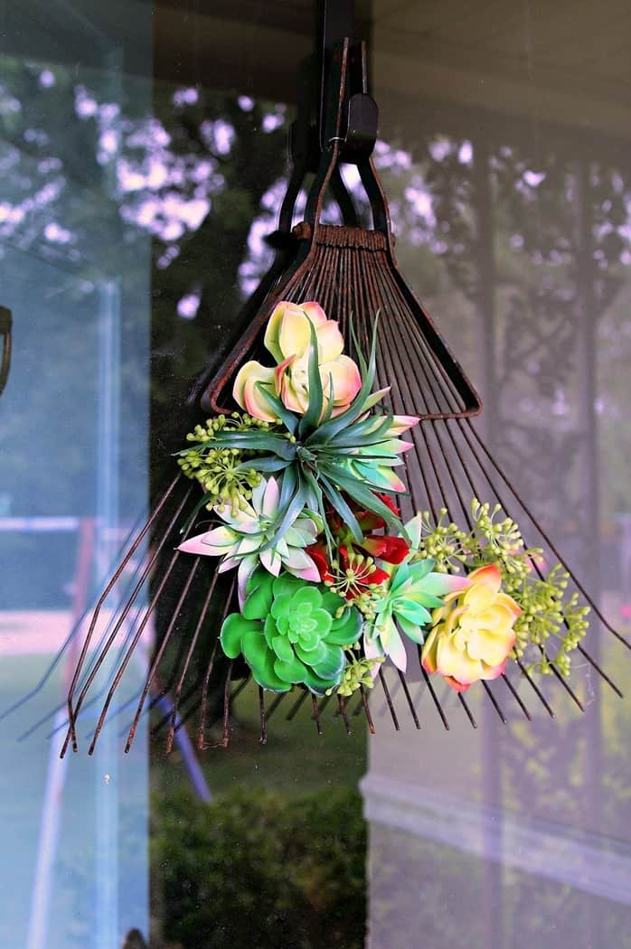 succulent flowers rusty rake container display idea