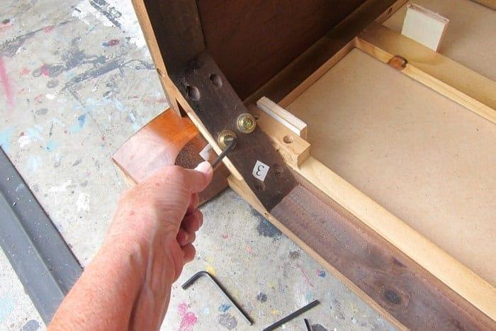 tighten screws on furniture