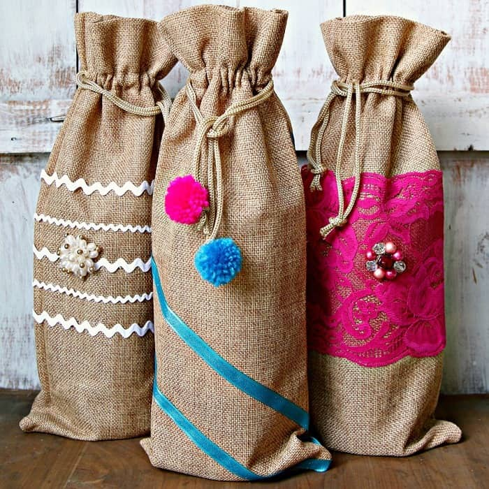 gift bags can be decorated with ribbon and trim