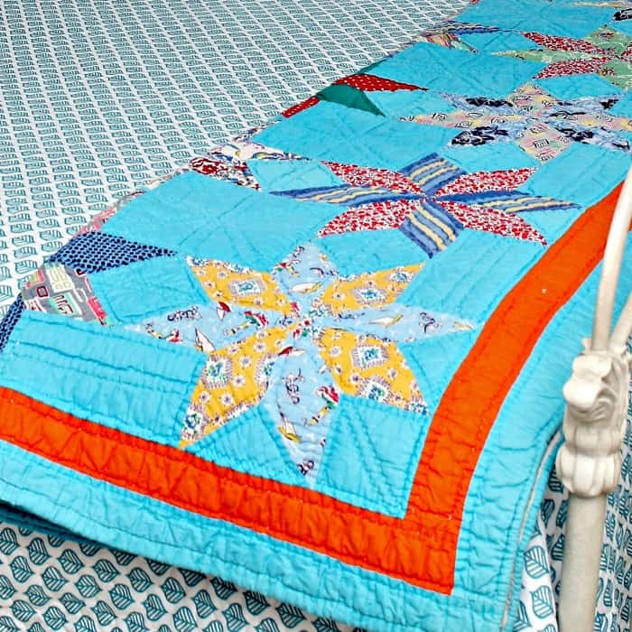 beautiful handmade quilt with turquoise and orange design