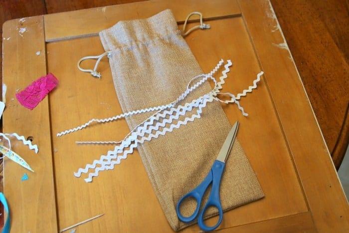 cut rick rack to decorate burlap bags