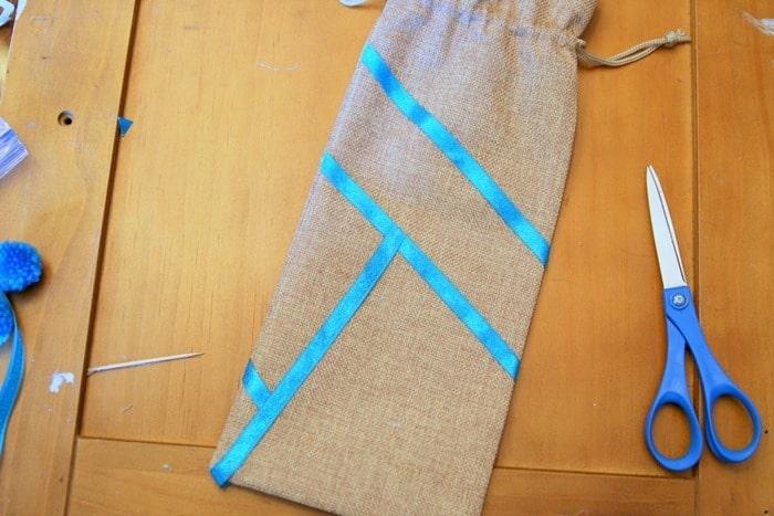 decorating a burlap bag with ribbon (2)