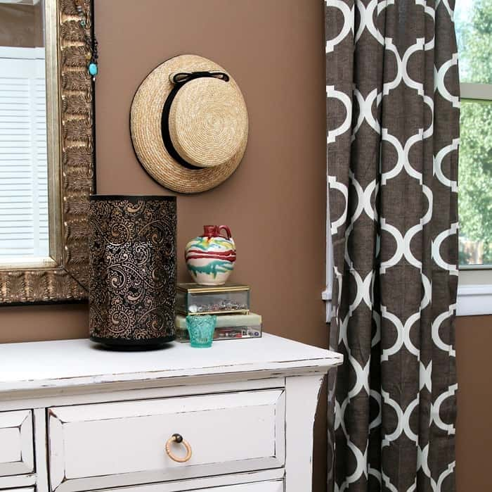 hang straw hats as wall decor