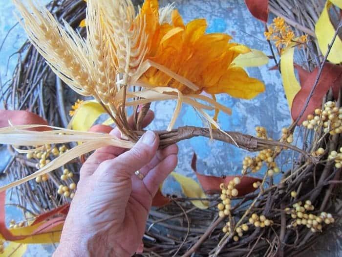 bend flower stem to go into grapevine wreath