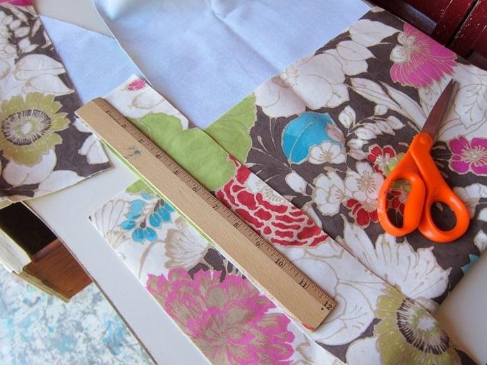 cutting up fabric to cover drawer bottom