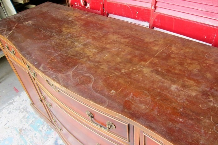 furniture surface damaged with scratches and water marks