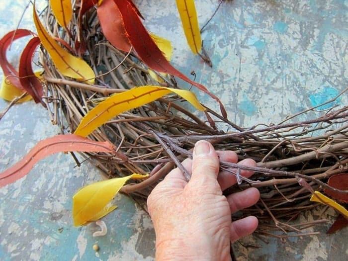 stick flower stems into grapevine wreath