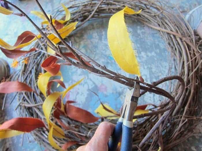 trim flower stems for wreath.