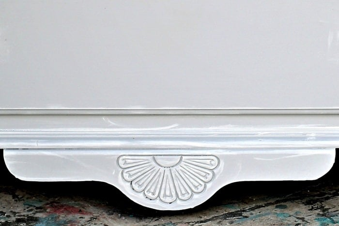 painted furniture detail highlighted with white paint