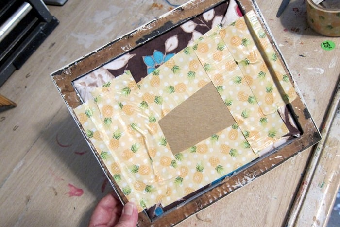 use duck tape to hold picture in frames