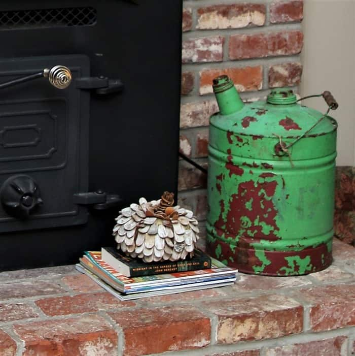 vintage gasoline can with rusty green paint