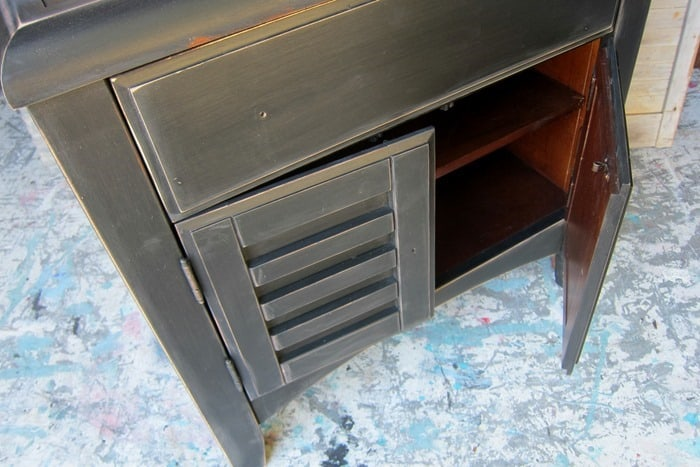 distressed black furniture needs to be waxed