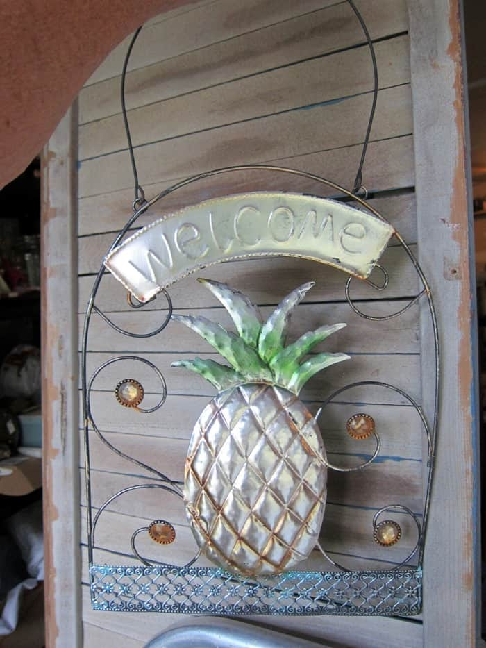 pineapple welcome signs bought at a yard sale