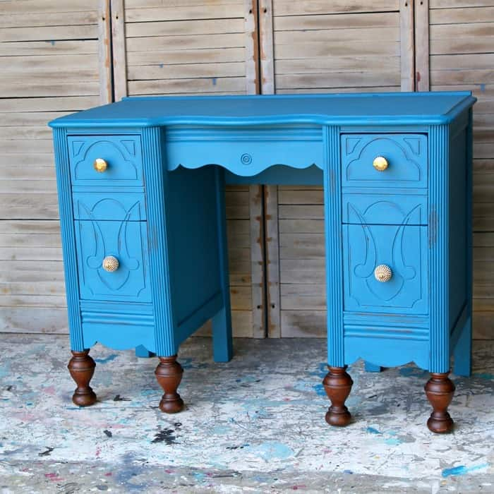 blue furniture vanity with gold knobs