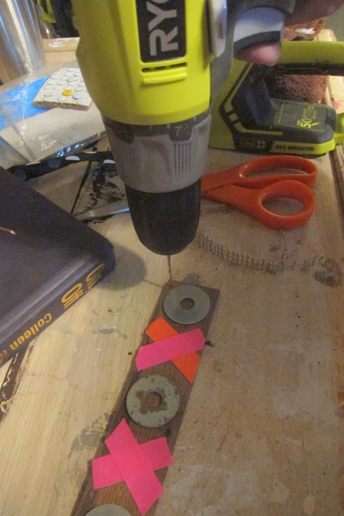 drilling a hole in wood using a Ryobi drill