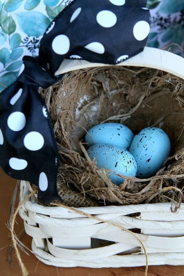 99 cent thrift store basket and bird nest with eggs display