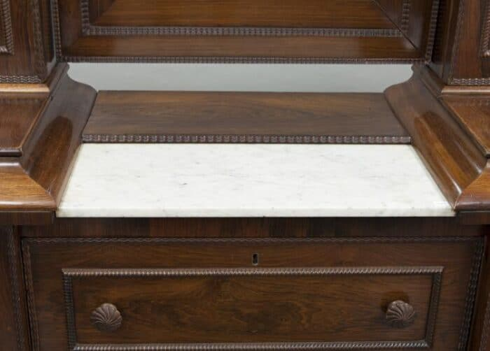 marble top on an antique wig dresser