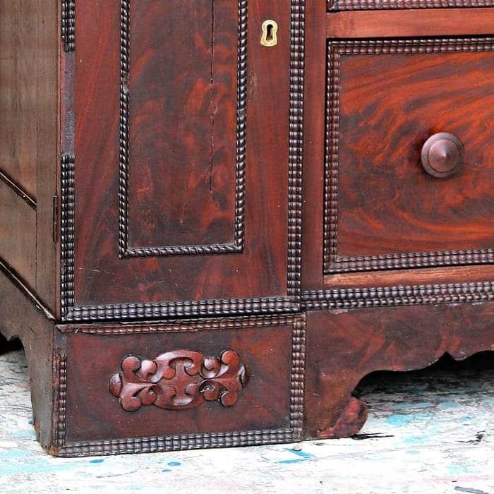 ornate details on antique wood dresser
