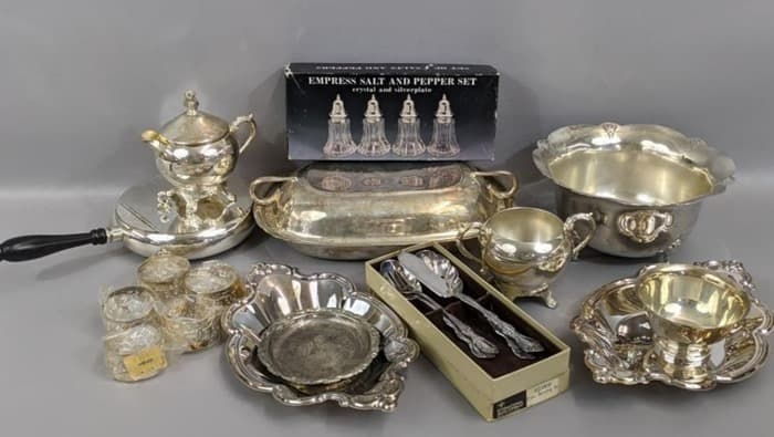 shiny silverplate dishes, trays, and salt and pepper shakers