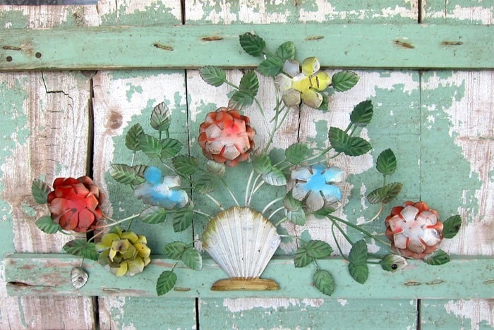 vintage metal flower decor attached to antique wood