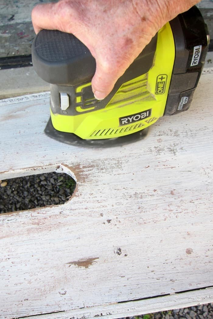 how to distress painted furnitue with a battery powered sander