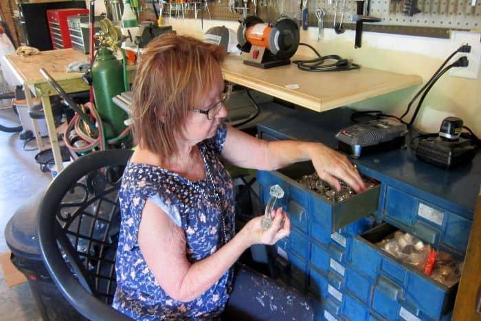 Kathy looking through her drawer knob stash