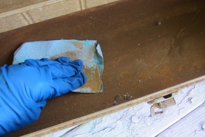 how to use sandpaper to remove rust