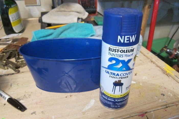 spray paint a tin with Rustoleum Spray Paint