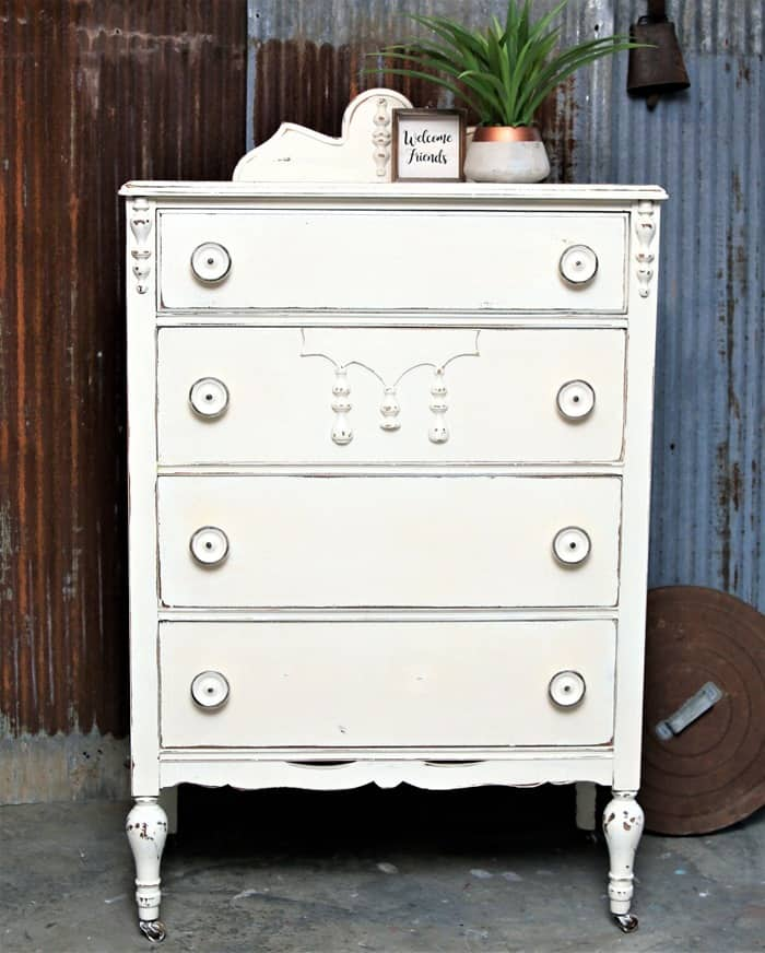 Furniture makeover with distressed white paint and big fat knobs