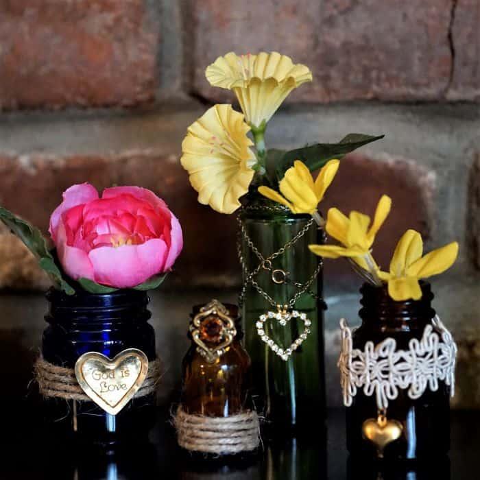 Make decorative flower vases using small vintage bottles