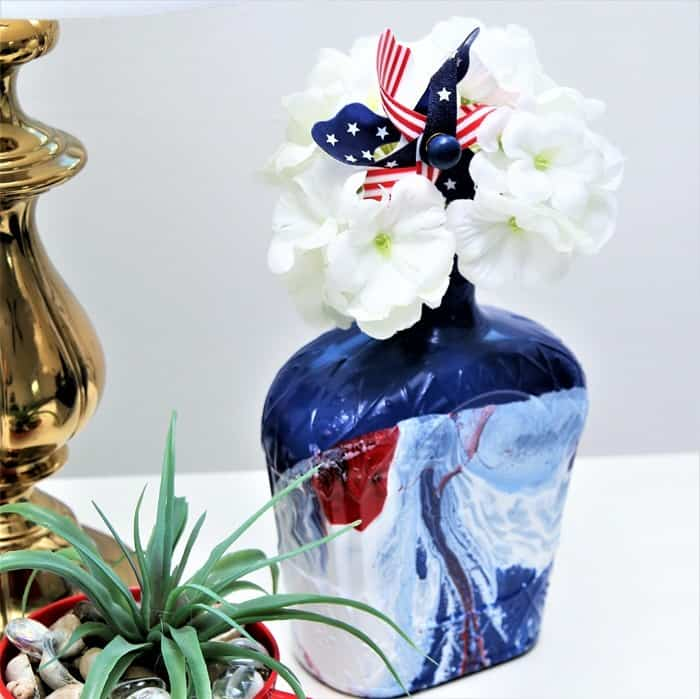 Rustoleum Spray Paint Hydro Dipped recycled bottle by Petticoat Junktion