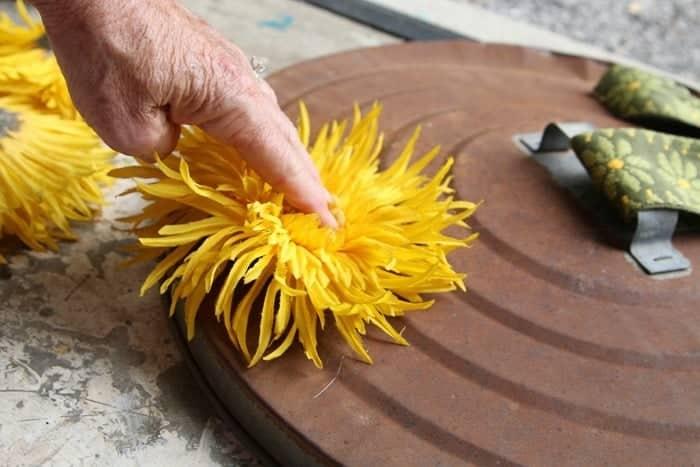 attach sunflowers to wreath
