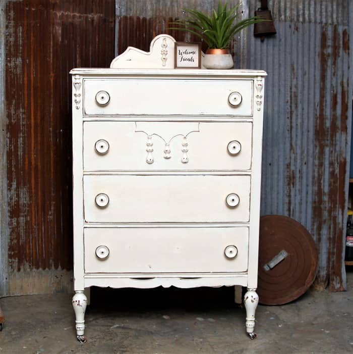 furniture makeover with distressed white paint and big wood knobs
