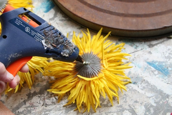 hot glue sunflowers to wreath form